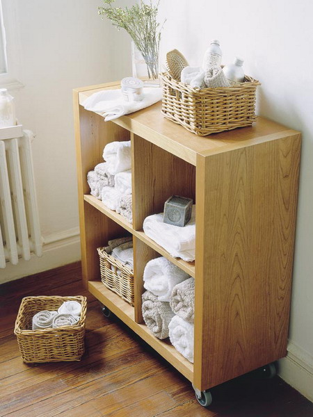 a storage unit on casters with open storage compartments - just insert some wicker cubbies for storing some small stuff