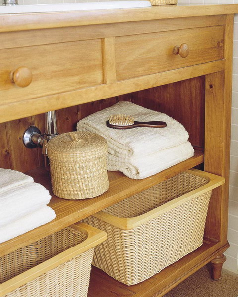 a large wooden bathroom vanity finished off with wicker cubbies to make storage more comfortable