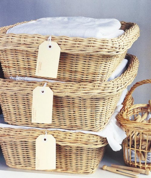 wicker cubbies with tags to mark what's insdie each of them - such an idea allows to stack these cubbies as you want