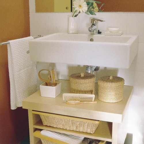 wicker cubbies for storage and small baskets with lids for various stuff are perfect for giving a slight farmhouse feel to the space