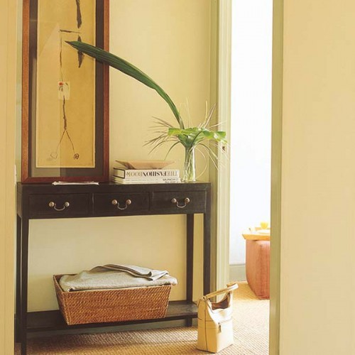 a black narrow entryway console table with a cubby to store various small stuff wherever you need