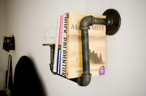 Pipe Bookshelf With Oil Candles