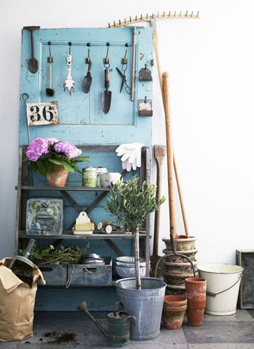 Turn a door into a hanging rack for gardening tools, via Shelterness