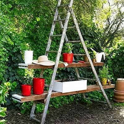Slats and ladder maketh a unique potting bench, via Shelterness