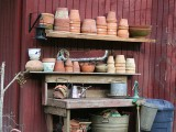 Potting Table With Lots Of Pot Storage
