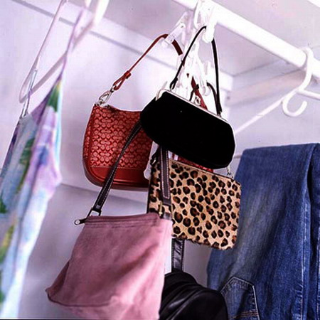 metal hooks in the closet is a a smart idea to hang your bags and not to waist space anywhere