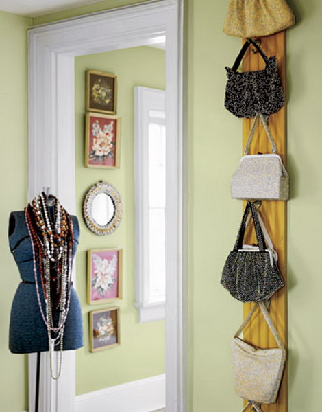 a wooden plank with hooks attached to the wall will hold a lot of bags and is easy to install in any closet