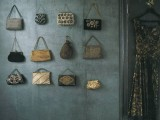 attach some hooks right on the wall in your closet and display all your bags comfortably to make choosing easier