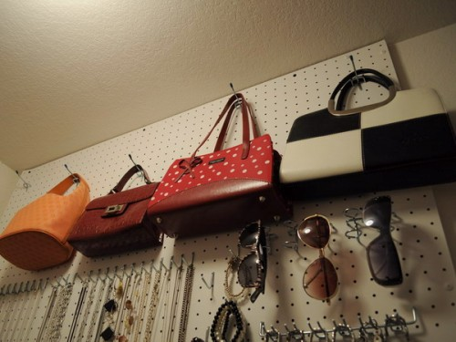 a pegboard is a brilliant idea for storing accessories, attach some hooks for the bags and sunglasses