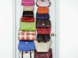 vertical door holders with hooks will save a lot of space in your closet if you use them