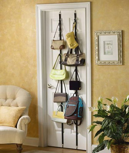 vertical metal holders with hooks attached to a door will hold a lot of bags and will save a lot of space