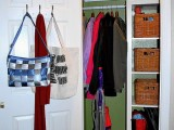 simple hooks on the door can hold all your bags and you won't have to sacrifice your shelf and floor space