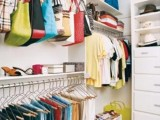 simple hooks hung in your closet instead of clothes hangers will be proper organizers for all your bags