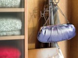 a regular clothes rack can hold a lot of bags – even if it's summer, don't take it away, let it be your holder