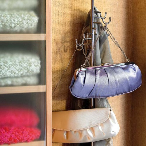 a regular clothes rack can hold a lot of bags - even if it's summer, don't take it away, let it be your holder