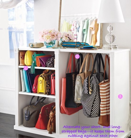 a special open drawer with several compartments to place and hang your bags is simply a perfect idea for a closet