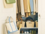 attach some hooks to the doors of your closet, and you'll get a clever hack for storing bags without wastign floor or shelf space