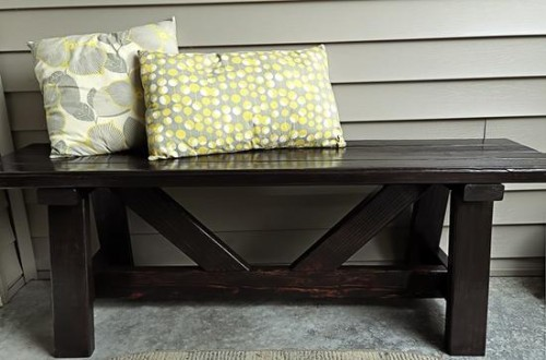 dark wood front porch bench (via diycozyhome)