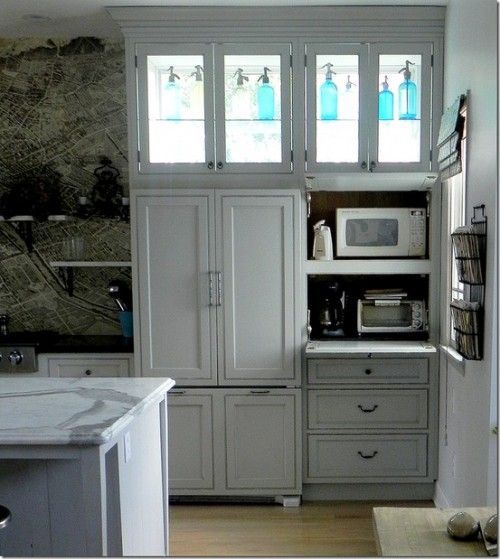 If you want to hide your microwave - a pullout shelf is a way to go.