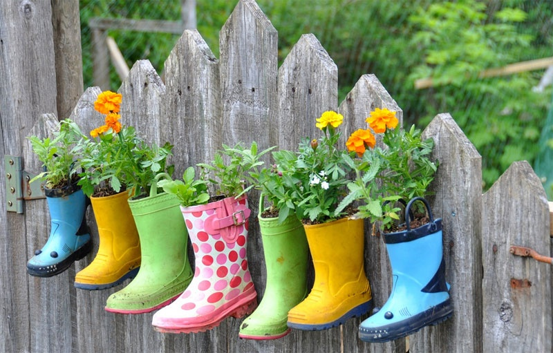 Rainboot Garden On A Fence