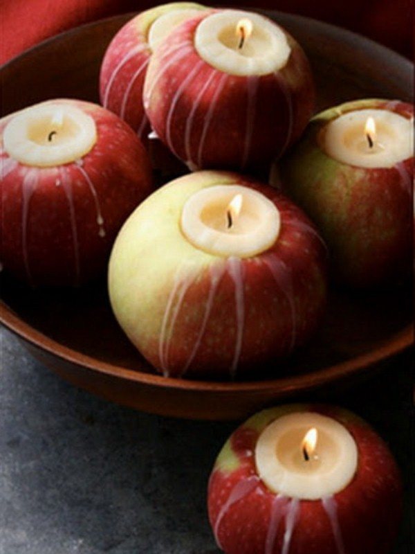 real apples used as candleholders are great for decorating for the fall, they are natural and fresh and you can make them fast