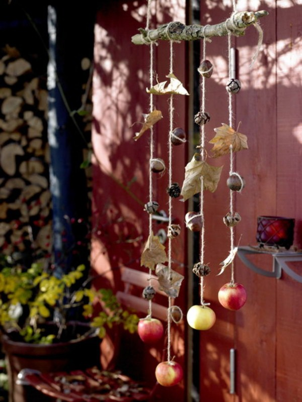a lovely natural fall hanging of acorns, nuts, apples, cinnamon and pinecones is perfect for the fall
