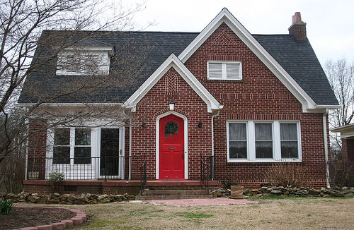 ... is a red front door too much my answer is no a red front door makes a