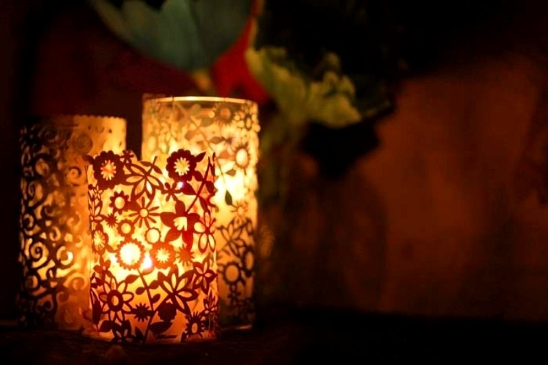 Picture Of romantic lacy candle holders of filigree and papel picado  4