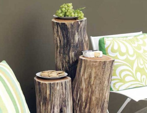 outdoor wooden table of logs (via shelterness)