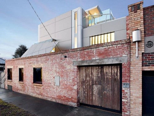 House with industrial exterior and minimalist interior for Industrial minimalist design