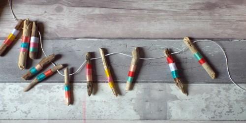 colorful yarn driftwood garland (via citygirlgonecoastal)