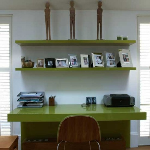 Floating shelves are perfect to display photos of your loved ones.