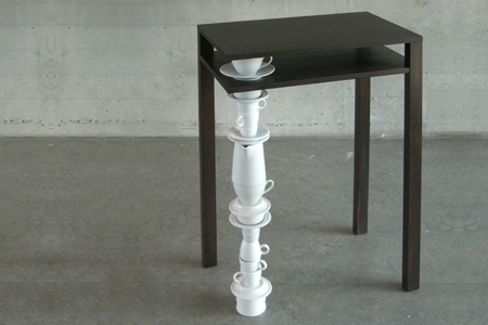 Side Table With One Leg Made Of Tableware
