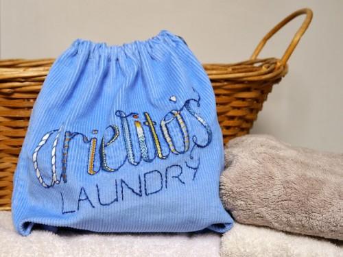 embroidered laundry bag (via saritacreative)