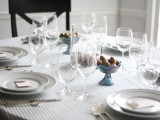 striped table setting with acorns