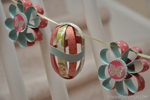 paper flowers and eggs garland (via happyclippings)
