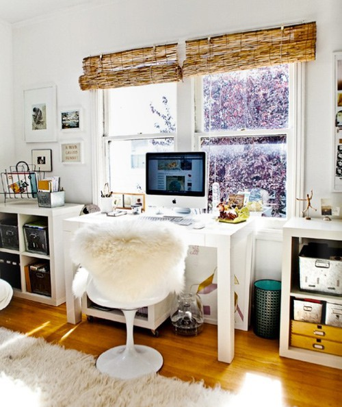 A desk looks great between two Kallax low storage units.