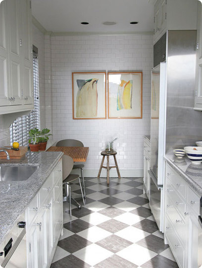 Really compact kitchen that is designed in two colors - white and gray