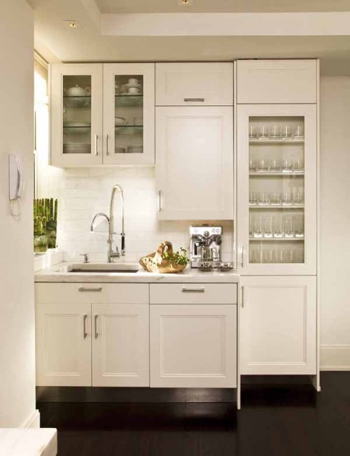 Floor to ceiling cabinets is a must if you want enough storage with a tiny layout.
