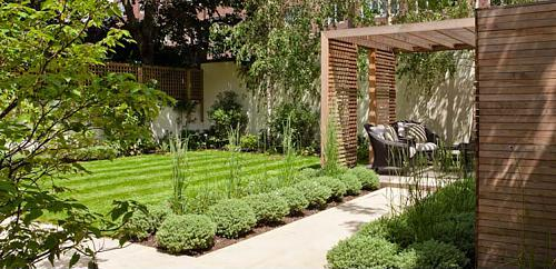 Small Garden Designs cozy and inspiring small garden designs with flowering plants and rail fence also garden table Clever Zoning Is A Must For Small Gardens