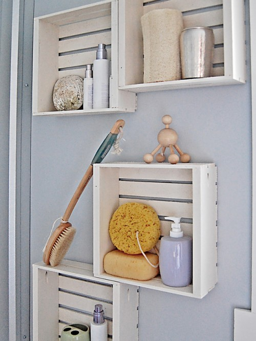 wall bathroom storage of crates (via hgtv)