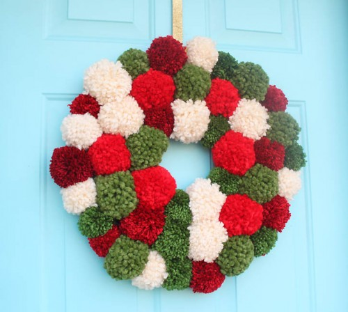 big pompom wreath (via gina-michele)