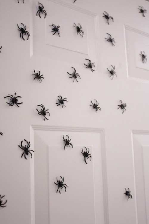 lots of tiny spiders can be attached to a door, a wall or some other surface to make it scary