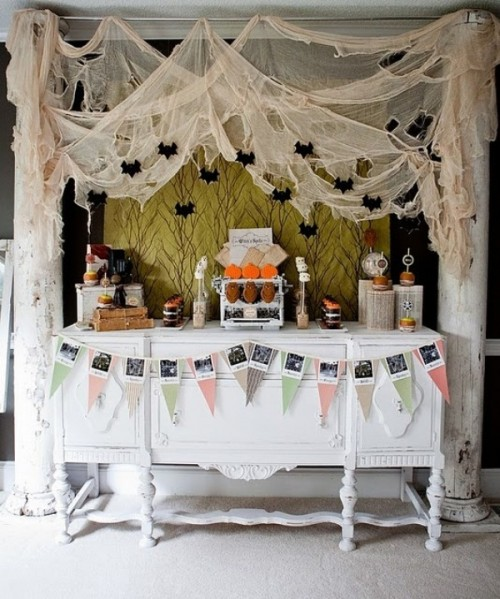 cheesecloth with bats and spiders hanging over the dessert table will make it look scary and Halloween-like
