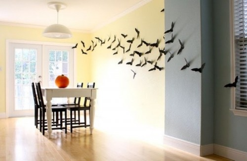 lots of bats attached to the wall make the dining room look Halloween-like without much effort