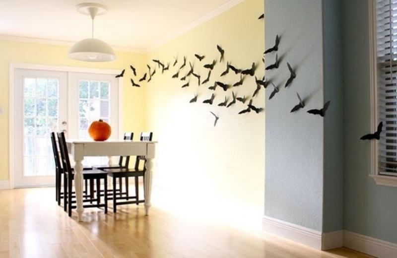 lots of bats attached to the wall make the dining room look Halloween like without much effort