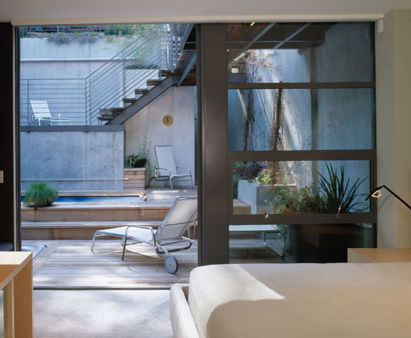 Stepping Up The Hill House With a Rear Japanese Garden photo