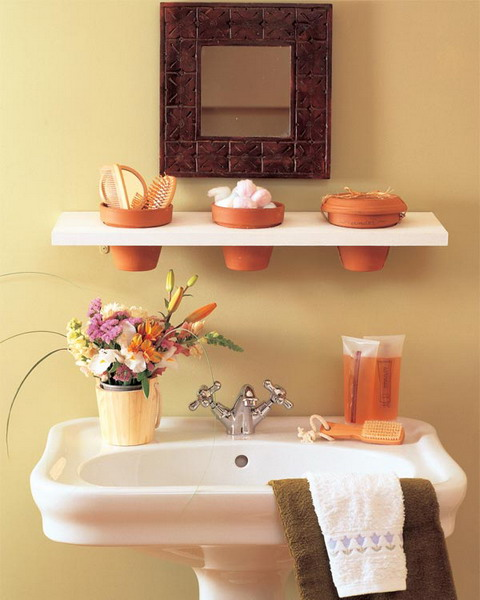 terra cotta pots could be used to organize your toothbrushes