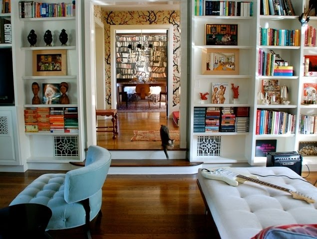 Picture of stylish built in shelves with a lot of things for Things to put on shelves in living room