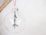 glass ornaments with silver pipe cleaners